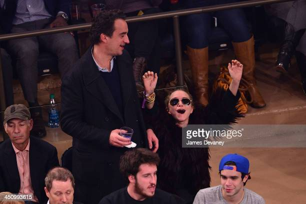 Olivier Sarkozy and MaryKate Olsen attend the Indiana Pacers vs New York Knicks game at Madison Square Garden on November 20 2013 in New York City