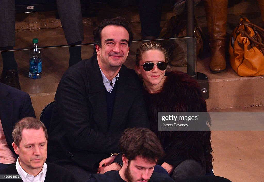 Olivier Sarkozy and Mary-Kate Olsen attend the Indiana Pacers vs New York Knicks game at Madison Square Garden on November 20, 2013 in New York City.