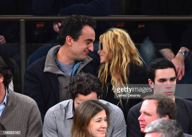 Olivier Sarkozy and MaryKate Olsen attend the Los Angeles Lakers vs New York Knicks game at Madison Square Garden on December 13 2012 in New York City