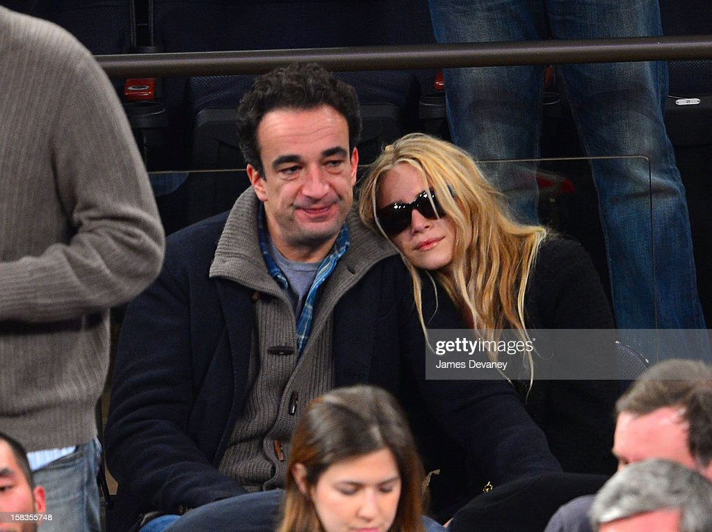 Olivier Sarkozy and Mary-Kate Olsen attend the Los Angeles Lakers vs New York Knicks game at Madison Square Garden on December 13, 2012 in New York City.