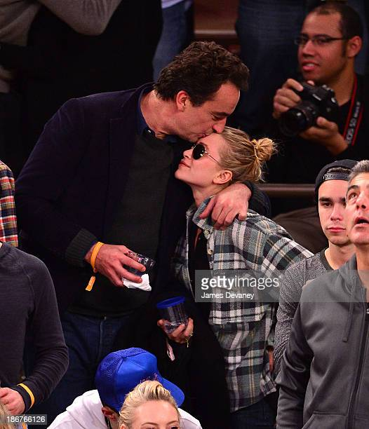 Olivier Sarkozy and MaryKate Olsen attend the Minnesota Timberwolves vs New York Knicks game at Madison Square Garden on November 3 2013 in New York...