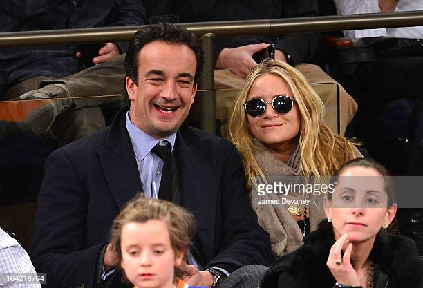 Olivier Sarkozy and MaryKate Olsen attend the Orlando Magic vs New York Knicks game at Madison Square Garden on March 20 2013 in New York City