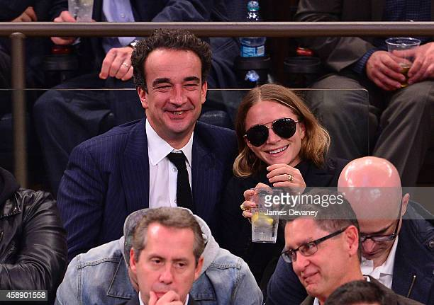 Olivier Sarkozy and MaryKate Olsen attend the Orlando Magic vs New York Knicks game at Madison Square Garden on November 12 2014 in New York City
