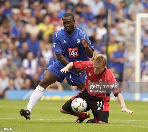 Olivier Tebily of Birmingham clashes with Damien Duff of Blackburn during the FA Barclaycard Premiership match between Birmingham City and Blackburn...