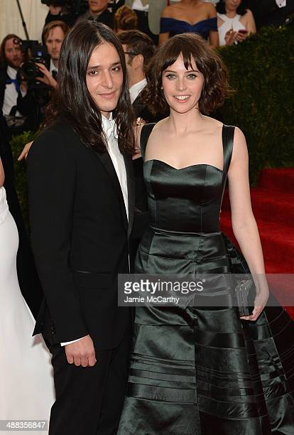 """Olivier Theyskens and Felicity Jones attend the """"Charles James: Beyond Fashion"""" Costume Institute Gala at the Metropolitan Museum of Art on May 5,..."""