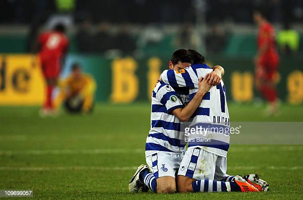 Olivier Veigneau of Duisburg celebrates with team mate Olcay Sahan after winning the DFB Cup semi final match between MSV Duisburg and Energie...