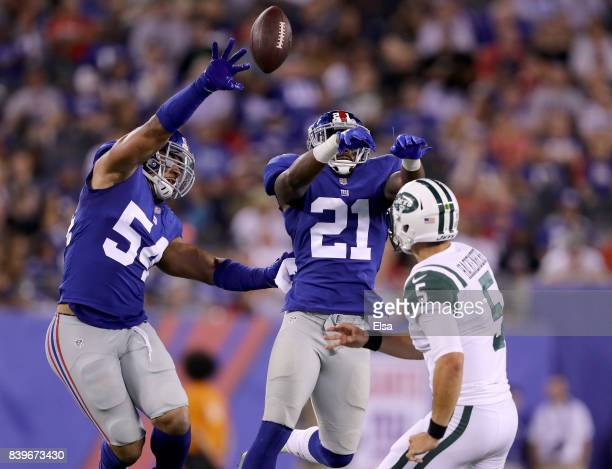 Olivier Vernon and Landon Collins of the New York Giants block a pass from Christian Hackenberg of the New York Jets in the second quarter during a...