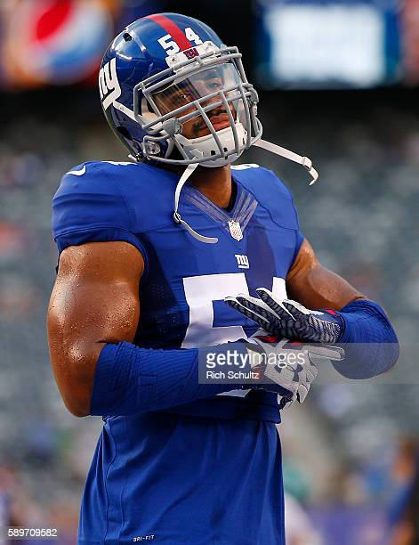 Olivier Vernon of the New York Giants during warm ups before an NFL preseason game against the Miami Dolphins at MetLife Stadium on August 12 2016 in...