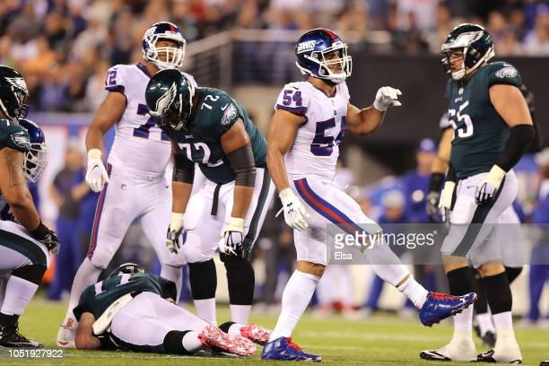 Olivier Vernon of the New York Giants reacts after sacking Carson Wentz of the Philadelphia Eagles during the third quarter at MetLife Stadium on...
