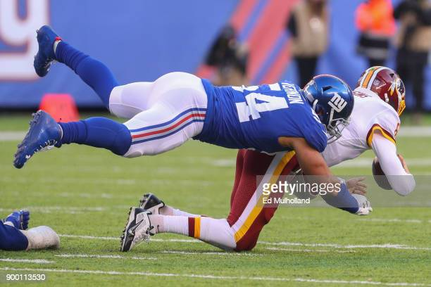Olivier Vernon of the New York Giants sacks Kirk Cousins of the Washington Redskins during the second half at MetLife Stadium on December 31 2017 in...