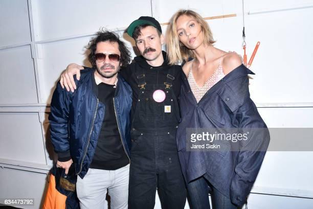 Olivier Zahm, Adam Selman and Anja Rubik pose backstage at the Adam Selman show during New York Fashion Week at Skylight Clarkson Sq on February 9,...