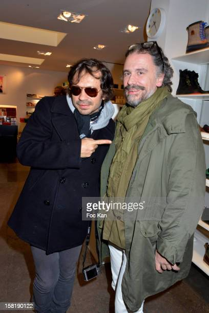 Olivier Zahm and Simon Liberati attend the Designer Kevin Lyons And Various Artists Exhibition Preview At Colette on December 10 2012 in Paris France