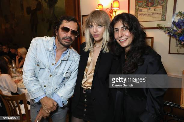 Olivier Zahm, Anja Rubik, and Yasmine Eslami attend a dinner in Paris to celebrate Another Magazine A/W17 hosted by Vivienne Westwood, Andreas...