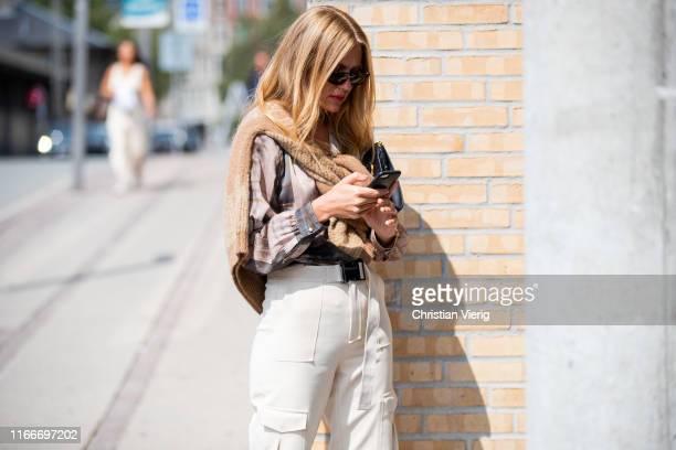 Olja Ryzevski is seen outside Holzweiler during Copenhagen Fashion Week Spring/Summer 2020 on August 07 2019 in Copenhagen Denmark