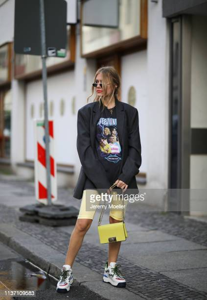 Olja Ryzevski wearing Blazer Ami Paris men collection TShirt Balenciaga yellow Shorts Vivetta Bag Bally Shoes fendi via Luisaviaroma Sunglasses...