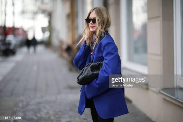 Olja Ryzevski wearing Blazer Maison Margiela via Luisaviaroma Tshirt Calvin Klein 205W39NYC collection via Luisaviaroma Shorts Vivetta Bag Bottega...