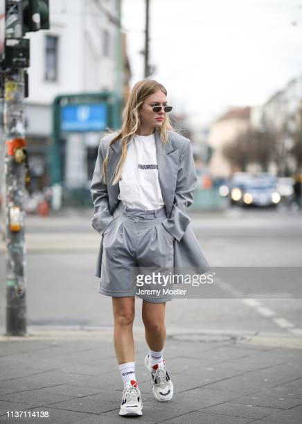 Olja Ryzevski wearing Blazer pants via @thefrankieshop Tshirt Calvin Klein 205W39NYC collection via netaporter Bag Maison Margiela Socks Vetements x...