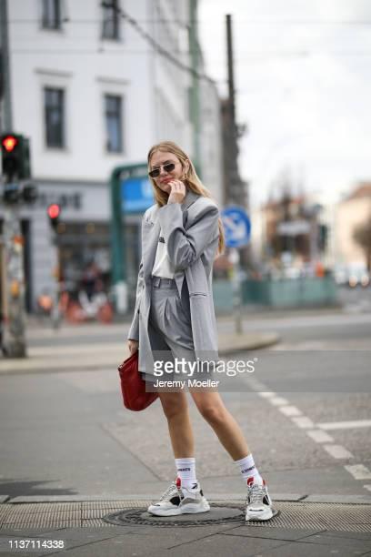 Olja Ryzevski wearing Blazer pants via @thefrankieshop Tshirt Calvin Klein 205W39NYC collection via netaporter Bag Maison Margiela Socks Vetements x...