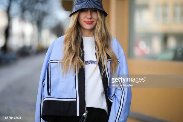 Olja Ryzevski wearing cap COS Tshirt Calvin Klein 205W39NYC Jacket sportmax Bag Furla Shorts Acne Studios on March 20 2019 in Berlin Germany