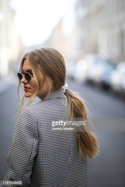 Olja Ryzevski wearing Coat Lalaberlin Sunglasses rayban on March 20 2019 in Berlin Germany
