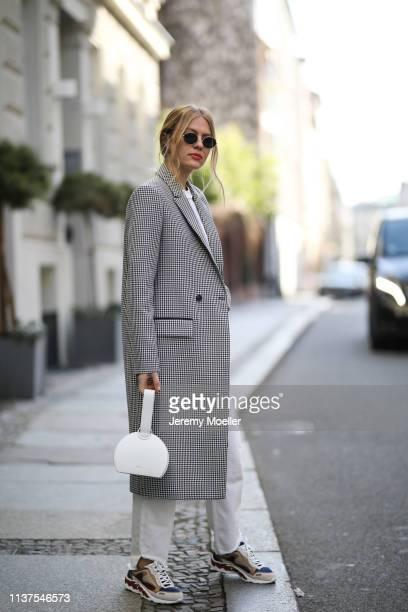 Olja Ryzevski wearing Coat Lalaberlin Tshirt vetements Shoes and pants Sandro paris Bag Polène Sunglasses rayban on March 20 2019 in Berlin Germany