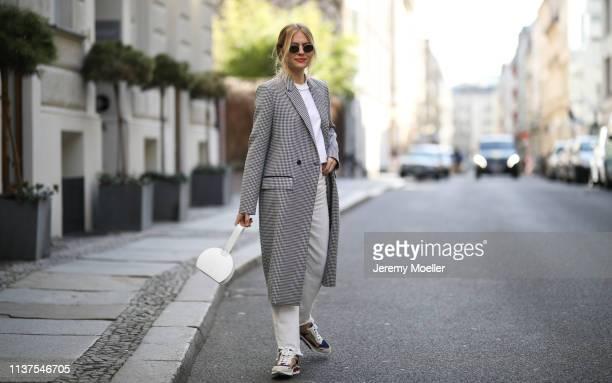 Olja Ryzevski wearing Coat Lalaberlin Tshirt vetements Shoes and pants Sandro paris Bag Polène Sunglasses rayban on March 20 2019 in Berlin Germany