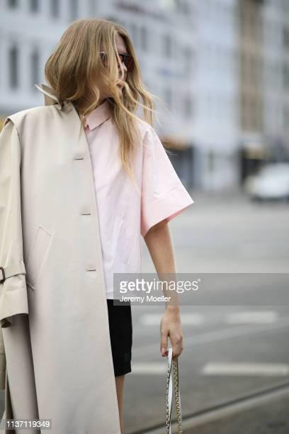 Olja Ryzevski wearing Coat Max Mara Shirt Jil Sander via netaporter Shorts Acne Studios Bag Furla Sunglasses Carrera on March 19 2019 in Berlin...