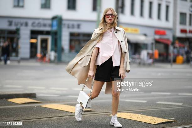 Olja Ryzevski wearing Coat Max Mara Shirt Jil Sander via netaporter Shorts Acne Studios Bag Furla Shoes JW Anderson x Converse Sunglasses Carrera on...