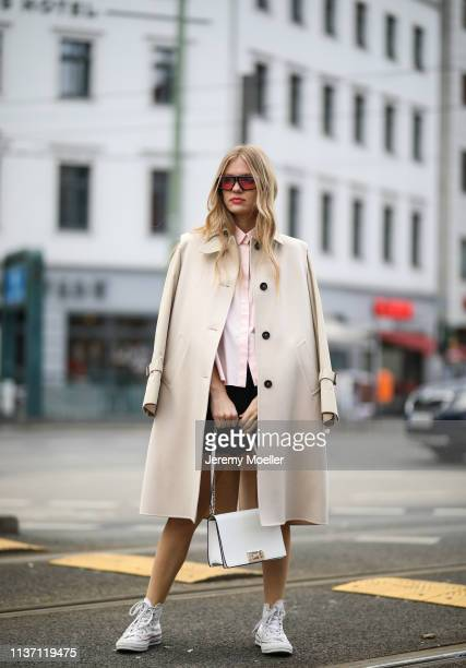 Olja Ryzevski wearing Coat Max Mara Shirt Jil Sander via netaporter Shorts Acne Studios Bag Furla Shoes JW Anderson x Converse Sunglasses Carrera on...