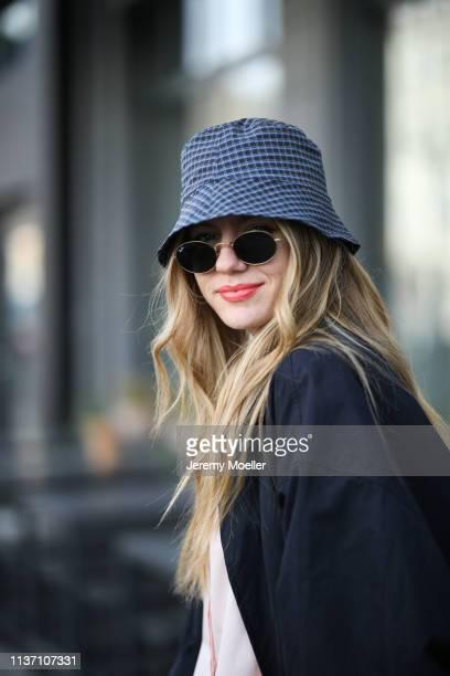 Olja Ryzevski wearing COS cap Jacquemus coat Shirt Jil Sander via netaporter Pants via thefrankieshop sunglasses rayban on March 19 2019 in Berlin...