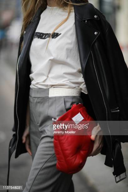 Olja Ryzevski wearing Jacket Acne Studios Tshirt vetements Pants Strenesse Bag Maison Margiela on March 20 2019 in Berlin Germany