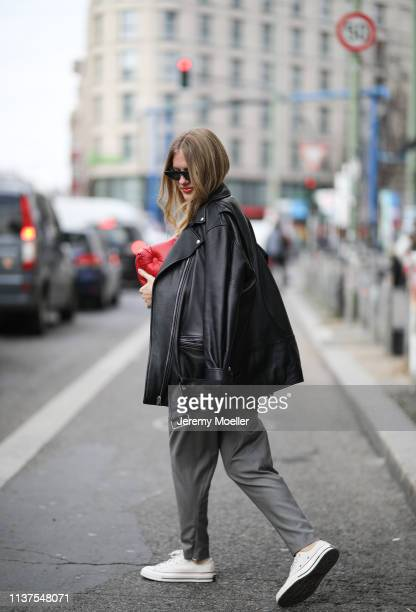 Olja Ryzevski wearing Jacket Acne Studios Tshirt vetements Pants Strenesse Bag Maison Margiela Sunglasses Polaroid Shoes converse on March 20 2019 in...