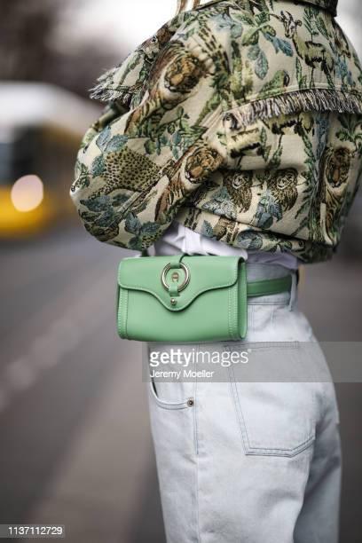Olja Ryzevski wearing Jacket Nanushka Tshirt vetements via netaporter Bag Aigner Jeans Alberta Ferretti via Luisaviaroma on March 19 2019 in Berlin...