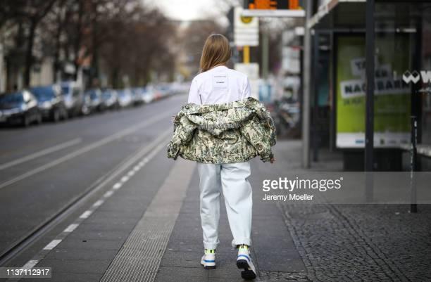 Olja Ryzevski wearing Jacket Nanushka Tshirt vetements via netaporter Bag Aigner Jeans Alberta Ferretti via Luisaviaroma Shoes Fendi via Luisaviaroma...