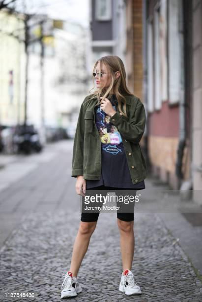 Olja Ryzevski wearing Jacket Sandro Paris, Shirt Balenciaga, Shorts Vivetta, Bag Samsoe Samsoe, Shoes Iro Paris, Sunglasses kuboraum via Luisaviaroma...