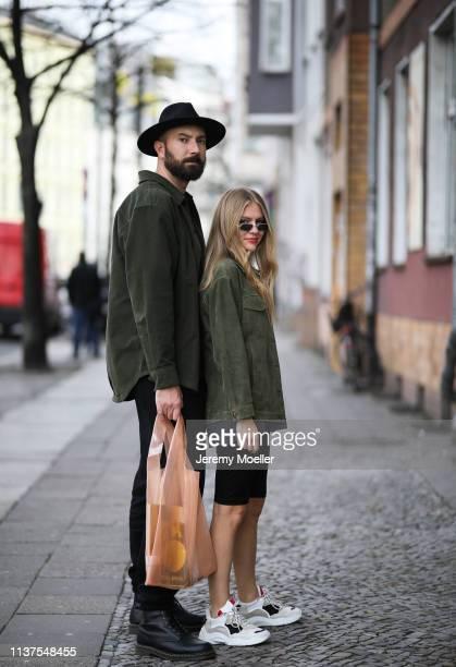 Olja Ryzevski wearing Jacket Sandro Paris Shirt Balenciaga Shorts Vivetta Bag Samsoe Samsoe Shoes Iro Paris Sunglasses kuboraum via Luisaviaroma and...