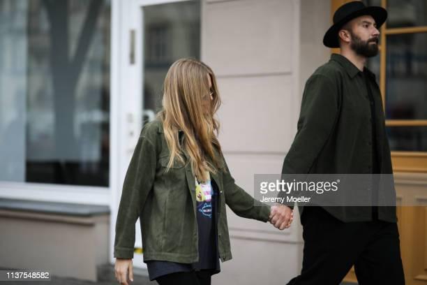 Olja Ryzevski wearing Jacket Sandro Paris Shirt Balenciaga Shorts Vivetta Bag Samsoe Samsoe Sunglasses kuboraum via Luisaviaroma and Mauricio...