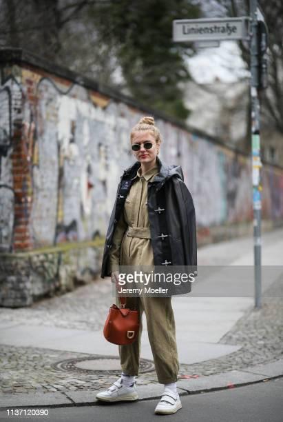Olja Ryzevski wearing Jumpsuit Iro Paris Jacket FAY Bag Danse Lente Sunglasses rayban Socks Vetements x Reebok via @matchesfashion shoes Acne Studios...