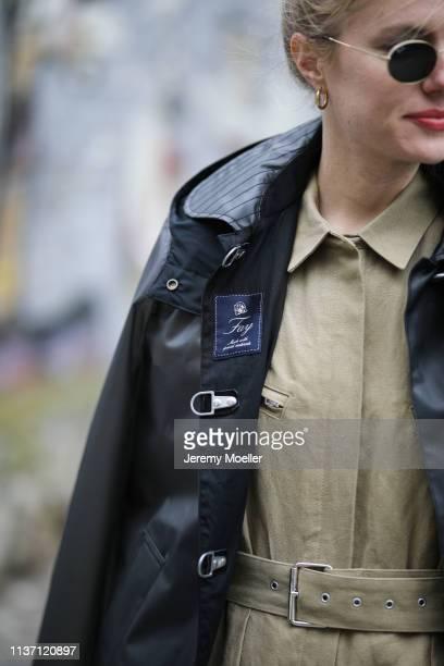 Olja Ryzevski wearing Jumpsuit Iro Paris Jacket FAY Bag Danse Lente Sunglasses rayban on March 19 2019 in Berlin Germany