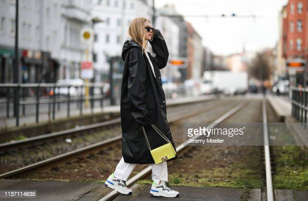 Olja Ryzevski wearing on Coat vetements via @luisaviaroma Tshirt vetements Sunglasses YUN Pants Sandro Paris Shoes fendi via Luisaviaroma Bag Furla...