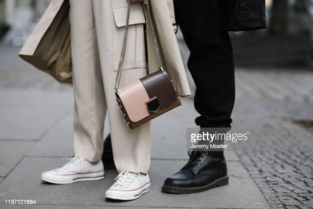 Olja Ryzevski wearing Pants massimo dutti Coat Sandro Paris Bag Jimmy Choo Shoes converse and Mauricio Corridan wearing Pants Carhartt Shoes Dr...