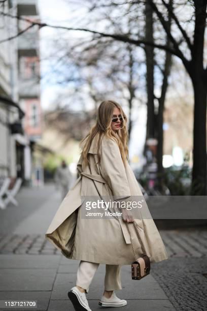 Olja Ryzevski wearing Tshirt acne studios Pants massimo dutti Coat Sandro Paris Bag Sunglasses Jimmy Choo Shoes converse on March 19 2019 in Berlin...