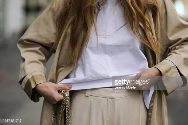 Olja Ryzevski wearing Tshirt acne studios Pants massimo dutti Coat Sandro Paris on March 19 2019 in Berlin Germany