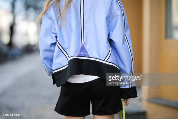 Olja Ryzevski wearing Tshirt Calvin Klein 205W39NYC Jacket sportmax Bag Furla Shorts Acne Studios on March 20 2019 in Berlin Germany