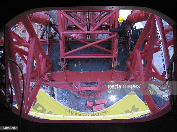 Picture released by Greenpeace showing a partial view of six Greenpeace activists continuing their occupation of a 100 meter high construction crane...
