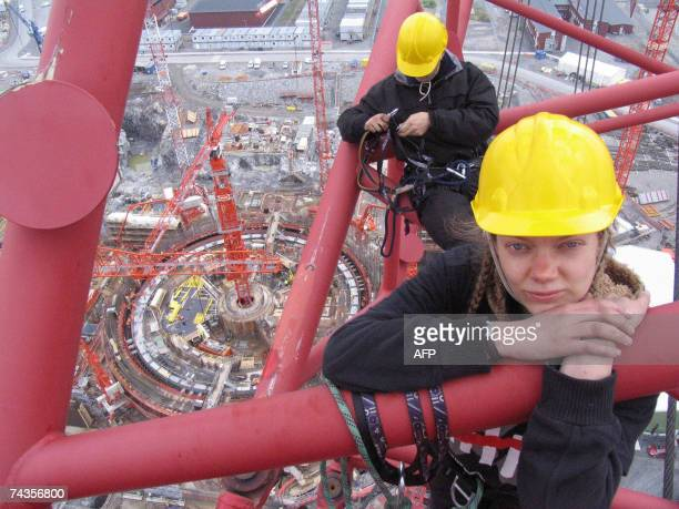 Picture released by Greenpeace showing two Greenpeace activists from a group of six continuing their occupation of a 100 meter high construction...