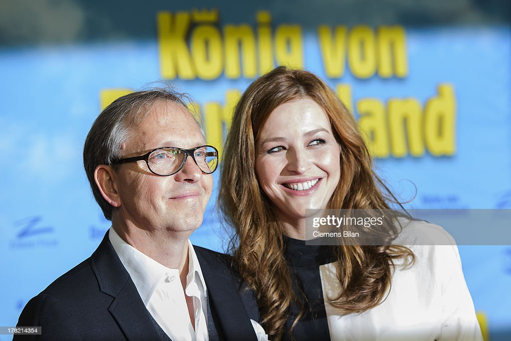 Olli Dittrich (L) and Katrin Bauerfeind attend the 'Koenig von Deutschland' Berlin premiere at Kino International on August 27, 2013 in Berlin, Germany.