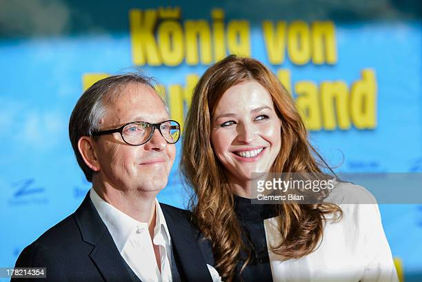 Olli Dittrich and Katrin Bauerfeind attend the 'Koenig von Deutschland' Berlin premiere at Kino International on August 27 2013 in Berlin Germany