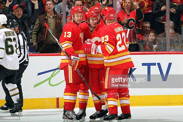 Olli Jokinen Curtis Glencross and Scott Hannan of the Calgary Flames celebrate a goal against the Dallas Stars on March 4 2012 at the Scotiabank...