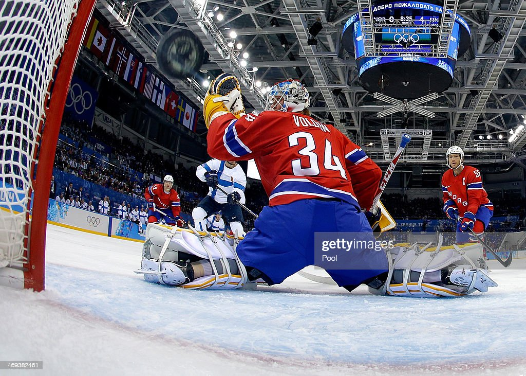 Olli Jokinen #12 of Finland shoots and scores against Lars Volden #34 of Norway in the second period during the Men's Ice Hockey Preliminary Round Group B game on day seven of the Sochi 2014 Winter Olympics at Bolshoy Ice Dome on February 14, 2014 in Sochi, Russia.